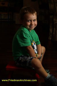 Boy Green Shirt Red Stool