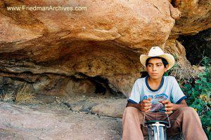 Boy with Hat near Rocks