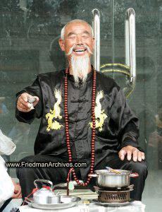 Happy man drinking tea