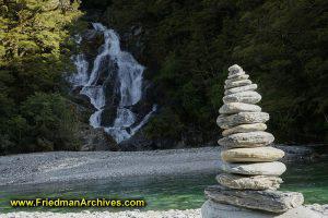 Waterfall and Inukshuk